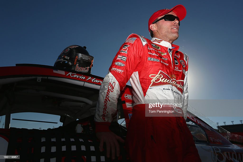 <a gi-track='captionPersonalityLinkClicked' href=/galleries/search?phrase=Kevin+Harvick&family=editorial&specificpeople=209186 ng-click='$event.stopPropagation()'>Kevin Harvick</a>, driver of the #29 Budweiser Chevrolet, stands on the grid during qualifying for the NASCAR Sprint Cup Series 13th Annual Hollywood Casino 400 at Kansas Speedway on October 4, 2013 in Kansas City, Kansas.