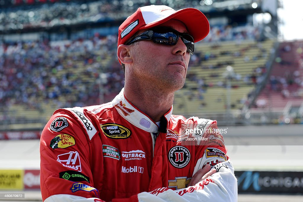 <a gi-track='captionPersonalityLinkClicked' href=/galleries/search?phrase=Kevin+Harvick&family=editorial&specificpeople=209186 ng-click='$event.stopPropagation()'>Kevin Harvick</a>, driver of the #4 Budweiser Chevrolet, stands on the grid during qualifying for the NASCAR Sprint Cup Series Quicken Loans 400 at Michigan International Speedway on June 13, 2014 in Brooklyn, Michigan.
