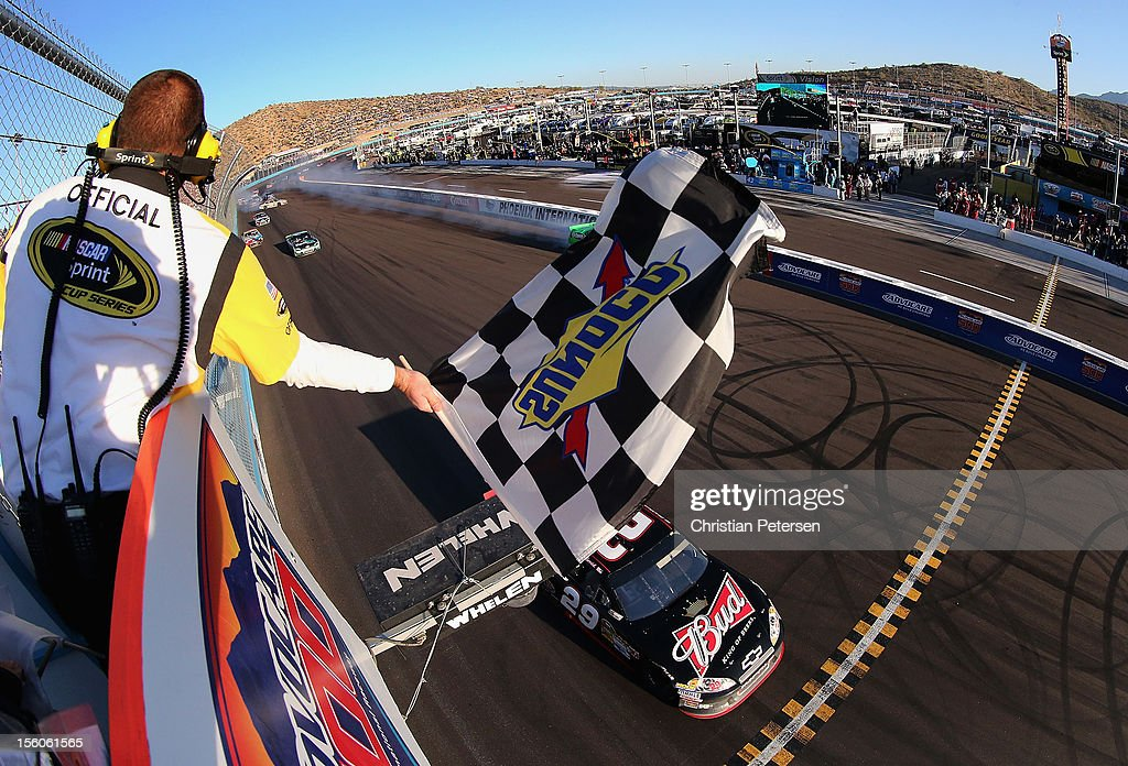 <a gi-track='captionPersonalityLinkClicked' href=/galleries/search?phrase=Kevin+Harvick&family=editorial&specificpeople=209186 ng-click='$event.stopPropagation()'>Kevin Harvick</a>, driver of the #29 Budweiser Chevrolet, takes the checkered flag to win the NASCAR Sprint Cup Series AdvoCare 500 at Phoenix International Raceway on November 11, 2012 in Avondale, Arizona.
