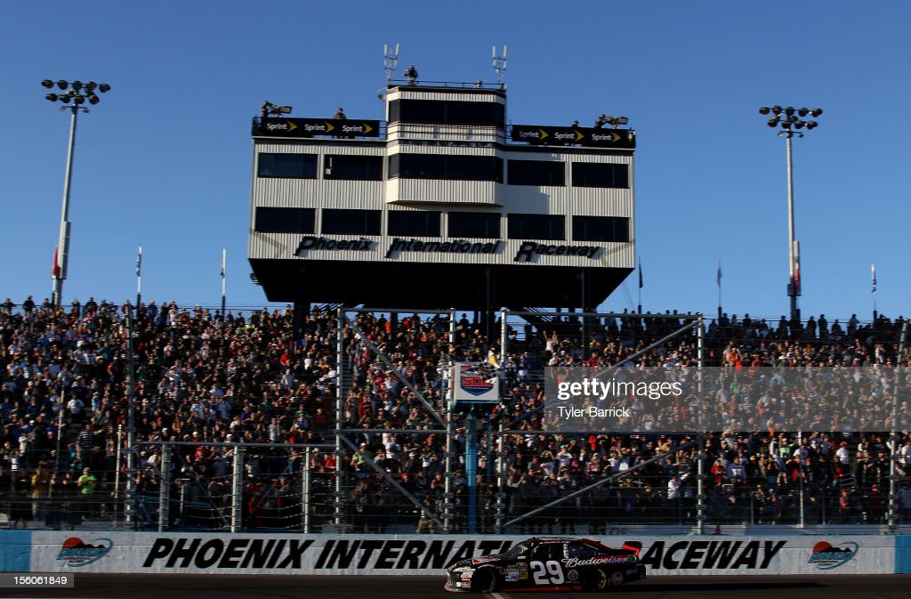 Kevin Harvick, driver of the #29 Budweiser Chevrolet, takes the checkered flag to win the NASCAR Sprint Cup Series AdvoCare 500 at Phoenix International Raceway on November 11, 2012 in Avondale, Arizona.