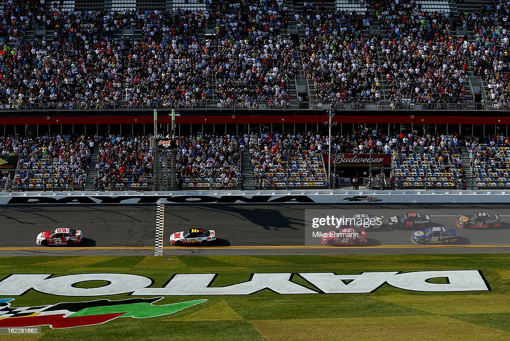 Kevin Harvick, driver of the #29 Budweiser Chevrolet, takes the checkered flag to win the NASCAR Sprint Cup Series Budweiser Duel 1 at Daytona International Speedway on February 21, 2013 in Daytona Beach, Florida.