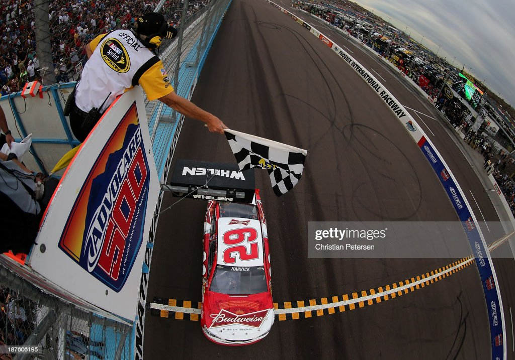 <a gi-track='captionPersonalityLinkClicked' href=/galleries/search?phrase=Kevin+Harvick&family=editorial&specificpeople=209186 ng-click='$event.stopPropagation()'>Kevin Harvick</a>, driver of the #29 Budweiser Chevrolet, takes the checkered flag as he crosses the finish line to win the NASCAR Sprint Cup Series AdvoCare 500 at Phoenix International Raceway on November 10, 2013 in Avondale, Arizona.
