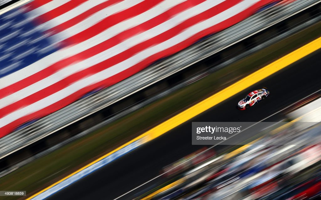 Kevin Harvick, driver of the #4 Budweiser Folds of Honor Chevrolet, races during the NASCAR Sprint Cup Series Coca-Cola 600 at Charlotte Motor Speedway on May 25, 2014 in Charlotte, North Carolina.