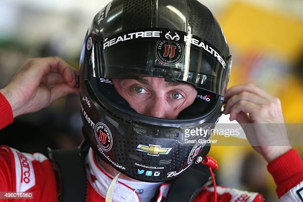 Kevin Harvick driver of the Budweiser/Jimmy John's Chevrolet adjusts his equipment in the garage area during practice for the NASCAR Sprint Cup...