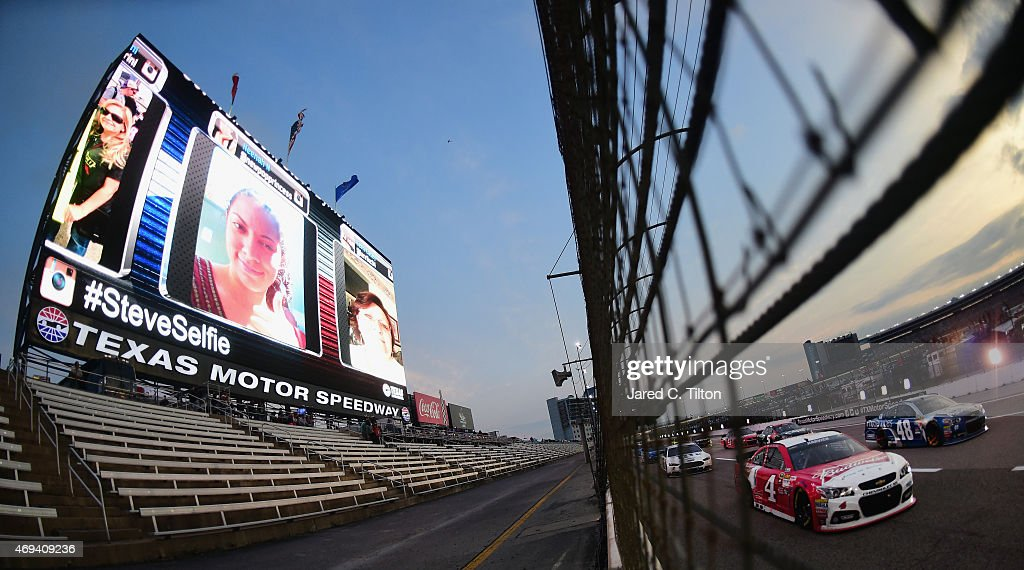 <a gi-track='captionPersonalityLinkClicked' href=/galleries/search?phrase=Kevin+Harvick&family=editorial&specificpeople=209186 ng-click='$event.stopPropagation()'>Kevin Harvick</a>, driver of the #4 Budweiser/Jimmy John's Chevrolet, and <a gi-track='captionPersonalityLinkClicked' href=/galleries/search?phrase=Jimmie+Johnson+-+Nascar+Race+Driver&family=editorial&specificpeople=171519 ng-click='$event.stopPropagation()'>Jimmie Johnson</a>, driver of the #48 Lowe's Pro Services Chevrolet, race during the NASCAR Sprint Cup Series Duck Commander 500 at Texas Motor Speedway on April 11, 2015 in Fort Worth, Texas.
