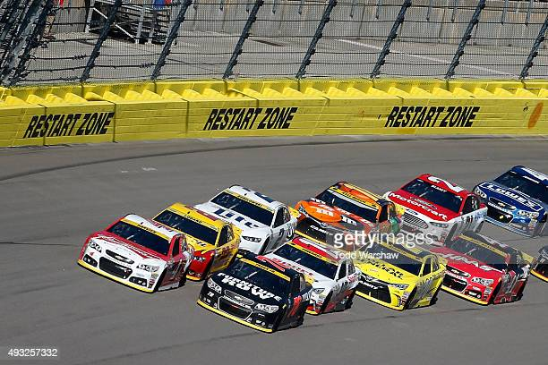 Kevin Harvick driver of the Budweiser/Jimmy John's Chevrolet and Martin Truex Jr driver of the Furniture Row/Visser Precision Chevrolet lead the...