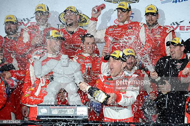 Kevin Harvick driver of the Budweiser/Jimmy John's Chevrolet celebrates in victory lane after winning the NASCAR Sprint Cup Series AAA 400 at Dover...