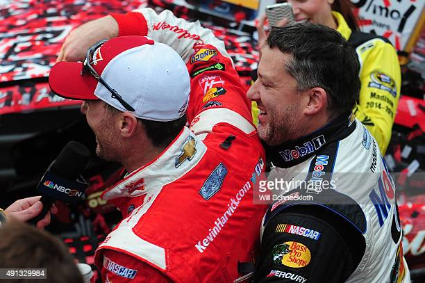 Kevin Harvick driver of the Budweiser/Jimmy John's Chevrolet is congratulated by team owner Tony Stewart driver of the Mobil 1/Bass Pro Shops...