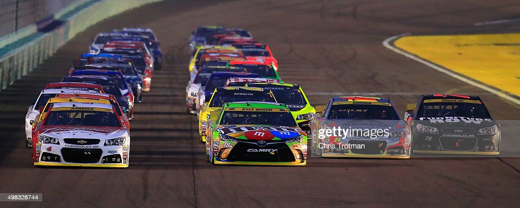 Kevin Harvick driver of the Budweiser/Jimmy John's Chevrolet Kyle Busch driver of the MM's Crispy Toyota Jeff Gordon driver of the AXALTA Chevrolet...