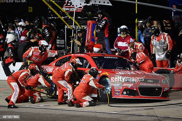 Kevin Harvick driver of the Budweiser/Jimmy John's Chevrolet pits during the NASCAR Sprint Cup Series Federated Auto Parts 400 at Richmond...