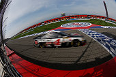 Kevin Harvick driver of the Budweiser/Jimmy John's Chevrolet races during the NASCAR Sprint Cup Series Auto Club 400 at Auto Club Speedway on March...