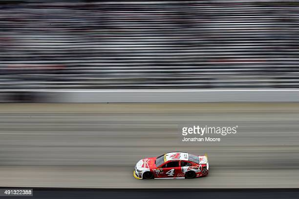 Kevin Harvick driver of the Budweiser/Jimmy John's Chevrolet races the NASCAR Sprint Cup Series AAA 400 at Dover International Speedway on October 4...