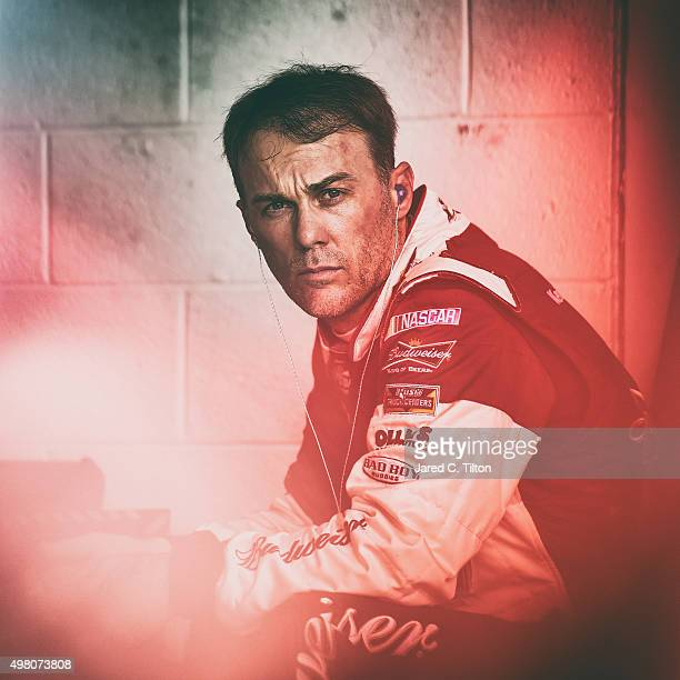 Kevin Harvick driver of the Budweiser/Jimmy John's Chevrolet sits in the garage area during practice for the NASCAR Sprint Cup Series Ford EcoBoost...