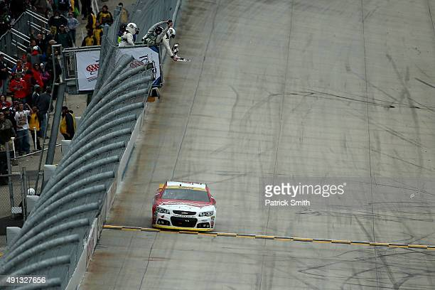 Kevin Harvick driver of the Budweiser/Jimmy John's Chevrolet takes the checkered flag to win the NASCAR Sprint Cup Series AAA 400 at Dover...