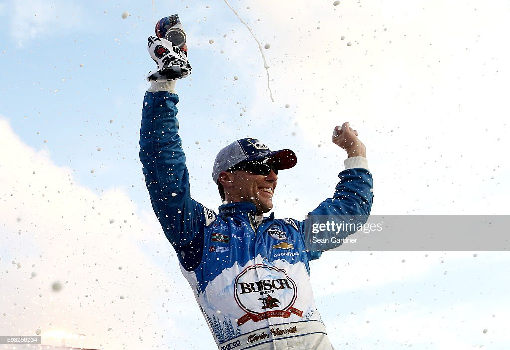 Kevin Harvick, driver of the #4 Busch Beer Chevrolet, celebrates in victory lane after winning the NASCAR Sprint Cup Series Bass Pro Shops NRA Night Race at Bristol Motor Speedway on August 21, 2016 in Bristol, Tennessee. The race was delayed due to inclement weather on Saturday, August 20.