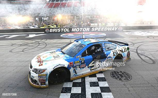 Kevin Harvick driver of the Busch Beer Chevrolet celebrates with a burnout after winning the NASCAR Sprint Cup Series Bass Pro Shops NRA Night Race...