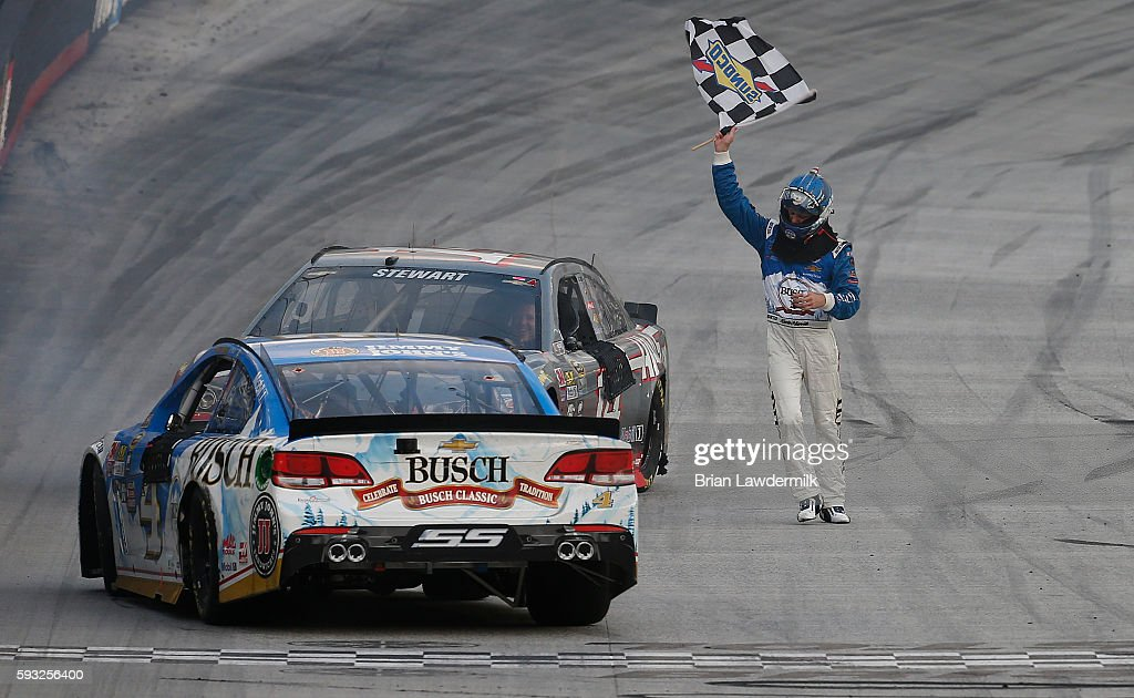 Kevin Harvick, driver of the #4 Busch Beer Chevrolet, celebrates with the checkered flag after winning the NASCAR Sprint Cup Series Bass Pro Shops NRA Night Race at Bristol Motor Speedway on August 21, 2016 in Bristol, Tennessee. The race was delayed due to inclement weather on Saturday, August 20.
