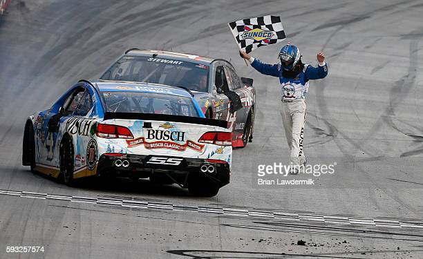 Kevin Harvick driver of the Busch Beer Chevrolet celebrates with the checkered flag after winning the NASCAR Sprint Cup Series Bass Pro Shops NRA...