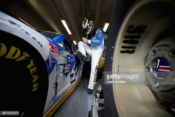Kevin Harvick driver of the Busch Beer Chevrolet climbs into his car during practice for the NASCAR Sprint Cup Series AAA Texas 500 at Texas Motor...