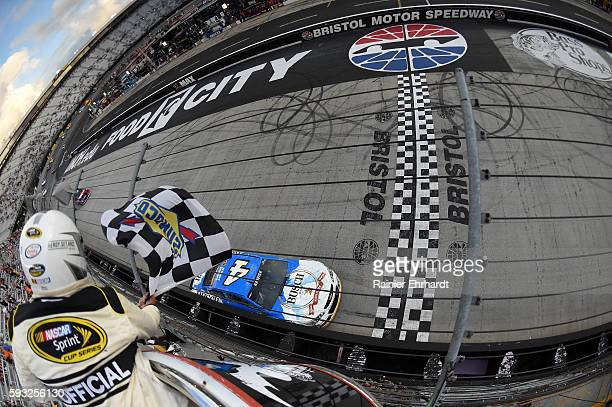 Kevin Harvick driver of the Busch Beer Chevrolet takes the checkered flag to win the NASCAR Sprint Cup Series Bass Pro Shops NRA Night Race at...