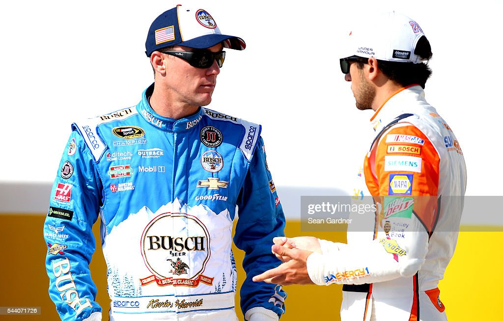 Kevin Harvick, driver of the #4 Busch Beer Chevrolet, talks to Chase Elliott, driver of the #24 SunEnergy1 Chevrolet, during practice for the NASCAR Sprint Cup Series Coke Zero 400 at Daytona International Speedway on July 1, 2016 in Daytona Beach, Florida.