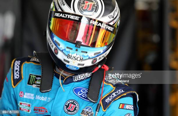 Kevin Harvick driver of the Busch Beer Ford stands in the garage area during practice for the Monster Energy NASCAR Cup Series Axalta presents the...