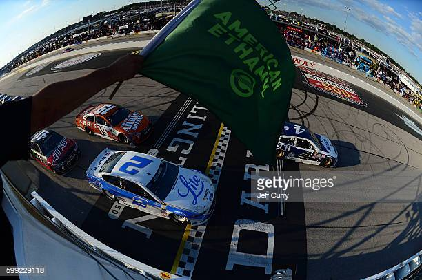 Kevin Harvick driver of the Busch Chevrolet leads the field to the green flag during the start of the NASCAR Sprint Cup Series Bojangles' Southern...