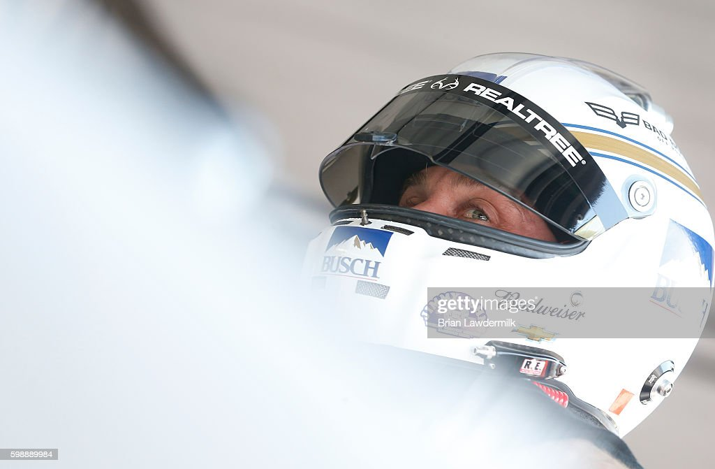 Kevin Harvick, driver of the #4 Busch Chevrolet, stands in the garage during practice for the NASCAR Sprint Cup Series Bojangles' Southern 500 at Darlington Raceway on September 3, 2016 in Darlington, South Carolina.