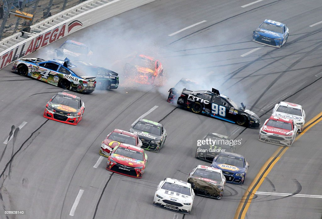 Kevin Harvick, driver of the #4 Busch Fishing Chevrolet, and Cole Whitt, driver of the #98 RticCoolers.com Chevrolet, have an on track incident during the NASCAR Sprint Cup Series GEICO 500 at Talladega Superspeedway on May 1, 2016 in Talladega, Alabama.