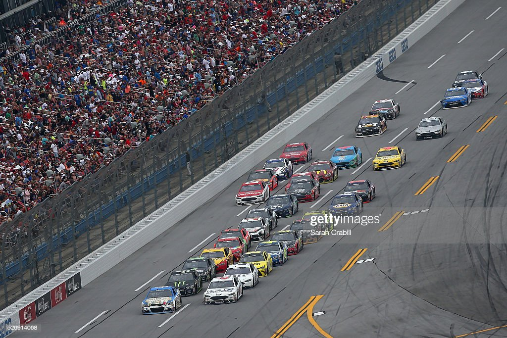 Kevin Harvick, driver of the #4 Busch Fishing Chevrolet, and Trevor Bayne, driver of the #6 AdvoCare Ford, lead a pack of cars during the NASCAR Sprint Cup Series GEICO 500 at Talladega Superspeedway on May 1, 2016 in Talladega, Alabama.