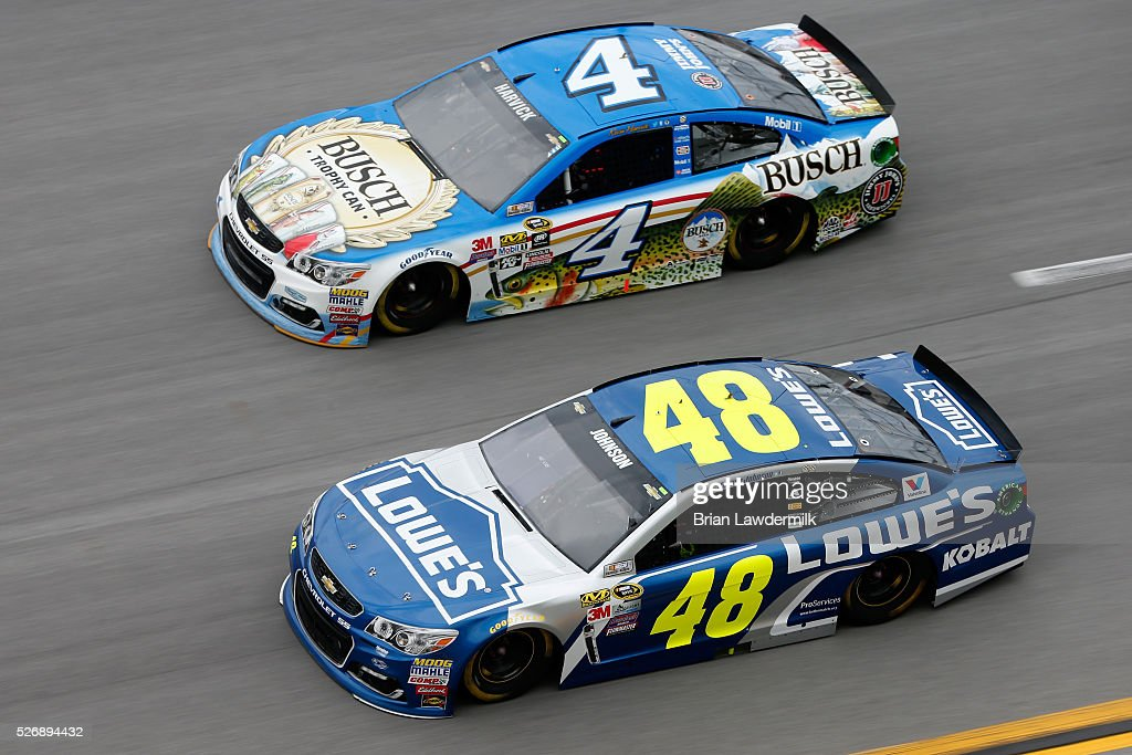 Kevin Harvick, driver of the #4 Busch Fishing Chevrolet, races Jimmie Johnson, driver of the #48 Lowe's Chevrolet, during the NASCAR Sprint Cup Series GEICO 500 at Talladega Superspeedway on May 1, 2016 in Talladega, Alabama.