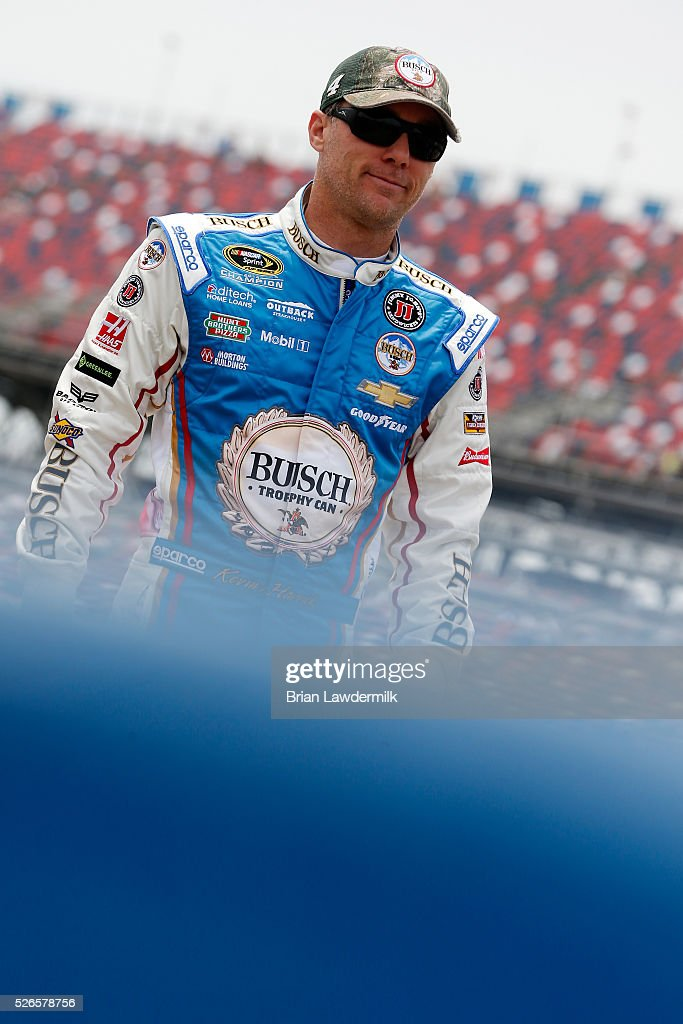 <a gi-track='captionPersonalityLinkClicked' href=/galleries/search?phrase=Kevin+Harvick&family=editorial&specificpeople=209186 ng-click='$event.stopPropagation()'>Kevin Harvick</a>, driver of the #4 Busch Fishing Chevrolet, stands on the grid during qualifying for the NASCAR Sprint Cup Series GEICO 500 at Talladega Superspeedway on April 30, 2016 in Talladega, Alabama.