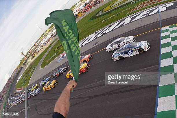 Kevin Harvick driver of the Busch Light Chevrolet leads the field past the green flag to start the NASCAR Sprint Cup Series Quaker State 400 at...