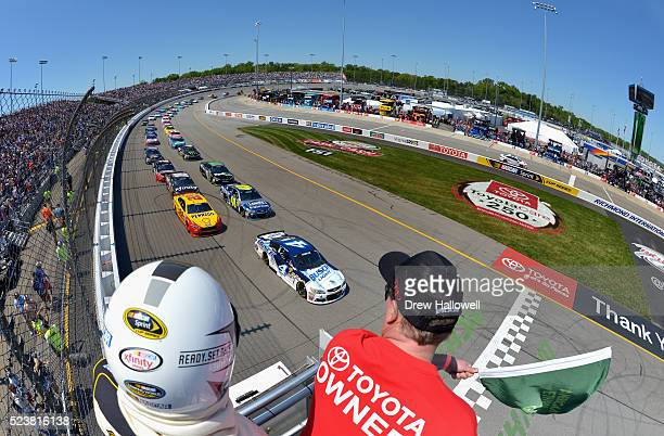 Kevin Harvick driver of the Busch Light Chevrolet leads the field to the green flag to start the NASCAR Sprint Cup Series TOYOTA OWNERS 400 at...