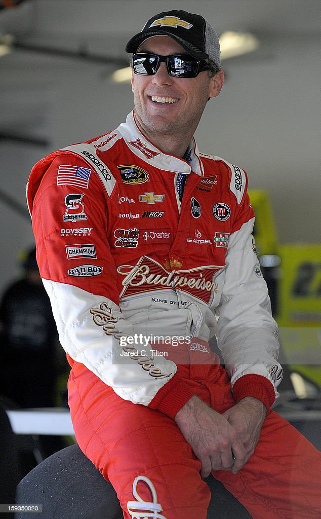 <a gi-track='captionPersonalityLinkClicked' href=/galleries/search?phrase=Kevin+Harvick&family=editorial&specificpeople=209186 ng-click='$event.stopPropagation()'>Kevin Harvick</a>, driver of the #29 Chevrolet, looks on in the garage area during NASCAR Sprint Cup Series Preseason Thunder testing at Daytona International Speedway on January 12, 2013 in Daytona Beach, Florida.