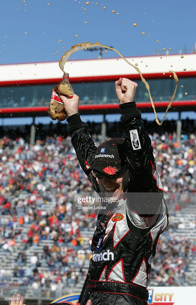 Kevin Harvick driver of the GM Goodwrench Chevrolet celebrates after winning the NASCAR Nextel Cup Food City 500 on April 3 2005 at the Bristol Motor...