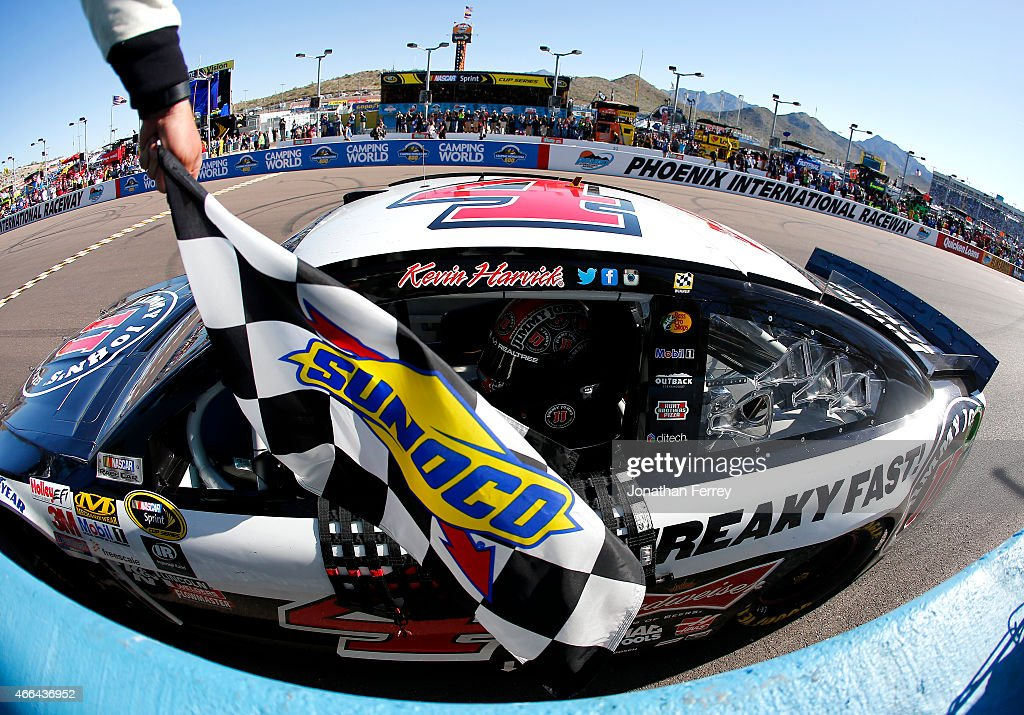 Kevin Harvick, driver of the #4 Jimmy John's/ Budweiser Chevrolet, celebrates after winning after winning the NASCAR Sprint Cup Series CampingWorld.com 500 at Phoenix International Raceway on March 15, 2015 in Avondale, Arizona.