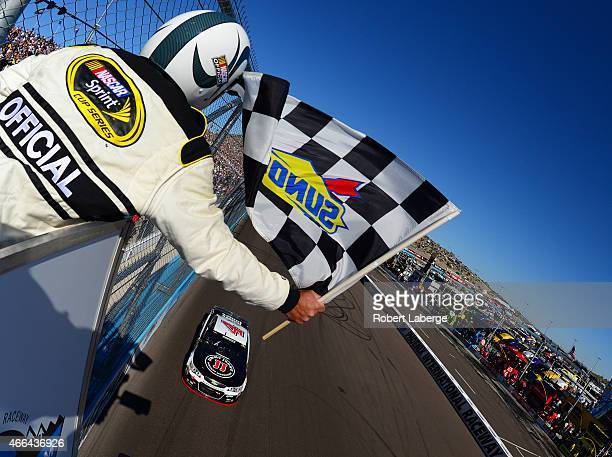 Kevin Harvick driver of the Jimmy John's/ Budweiser Chevrolet crosses the finish line to win the NASCAR Sprint Cup Series CampingWorldcom 500 at...
