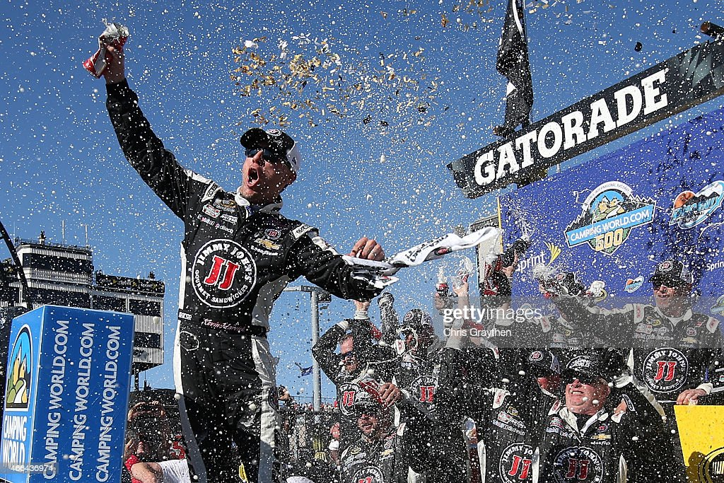 Kevin Harvick, driver of the #4 Jimmy John's/ Budweiser Chevrolet, celebrates in victory lane after winning the NASCAR Sprint Cup Series CampingWorld.com 500 at Phoenix International Raceway on March 15, 2015 in Avondale, Arizona.