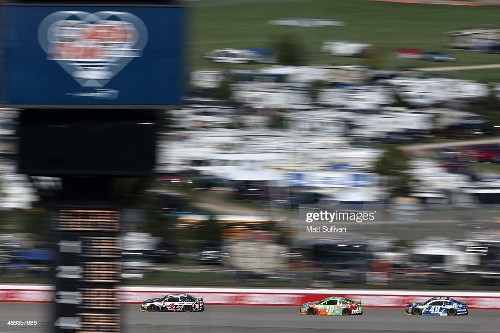 <a gi-track='captionPersonalityLinkClicked' href=/galleries/search?phrase=Kevin+Harvick&family=editorial&specificpeople=209186 ng-click='$event.stopPropagation()'>Kevin Harvick</a>, driver of the #4 Jimmy John's / Budweiser Chevrolet, <a gi-track='captionPersonalityLinkClicked' href=/galleries/search?phrase=Kyle+Busch&family=editorial&specificpeople=211123 ng-click='$event.stopPropagation()'>Kyle Busch</a>, driver of the #18 M&M's Crispy Toyota, and <a gi-track='captionPersonalityLinkClicked' href=/galleries/search?phrase=Jimmie+Johnson+-+Nascar+Race+Driver&family=editorial&specificpeople=171519 ng-click='$event.stopPropagation()'>Jimmie Johnson</a>, driver of the #48 Lowe's Chevrolet, race during the NASCAR Sprint Cup Series myAFibRisk.com 400 at Chicagoland Speedway on September 20, 2015 in Joliet, Illinois.