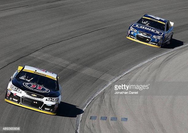 Kevin Harvick driver of the Jimmy John's / Budweiser Chevrolet leads Jimmie Johnson driver of the Lowe's Chevrolet during the NASCAR Sprint Cup...