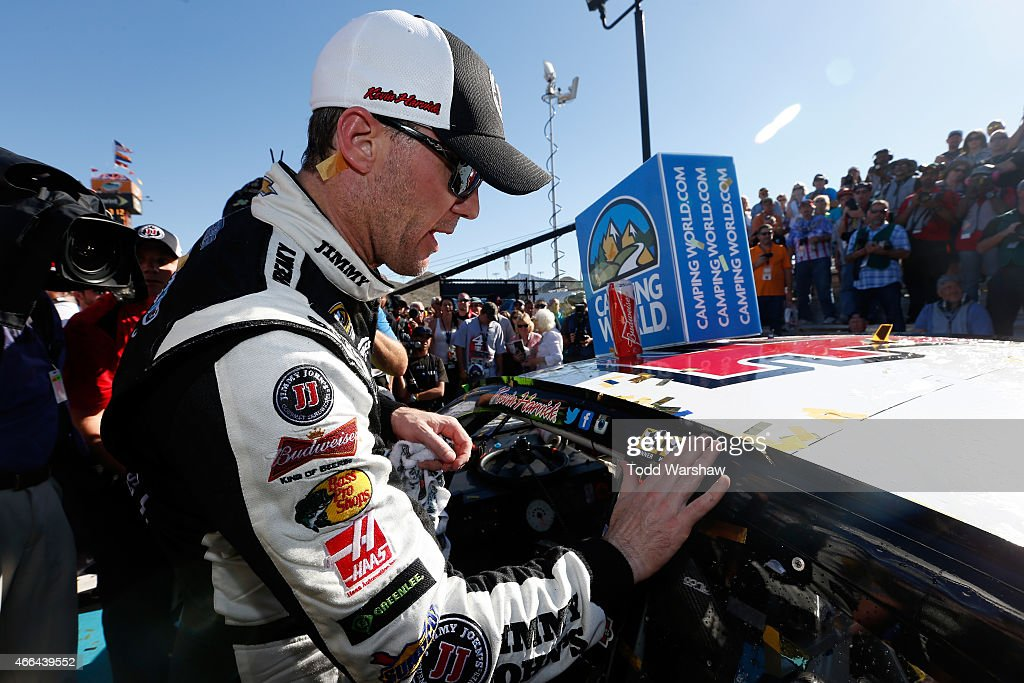 Kevin Harvick, driver of the #4 Jimmy John's/ Budweiser Chevrolet, puts the winner's sticker on his car after winning the NASCAR Sprint Cup Series CampingWorld.com 500 at Phoenix International Raceway on March 15, 2015 in Avondale, Arizona.