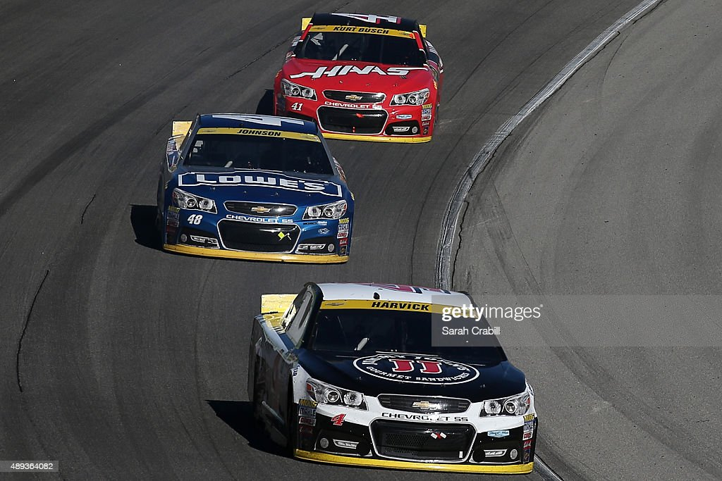 <a gi-track='captionPersonalityLinkClicked' href=/galleries/search?phrase=Kevin+Harvick&family=editorial&specificpeople=209186 ng-click='$event.stopPropagation()'>Kevin Harvick</a>, driver of the #4 Jimmy John's / Budweiser Chevrolet, races <a gi-track='captionPersonalityLinkClicked' href=/galleries/search?phrase=Jimmie+Johnson+-+Nascar+Race+Driver&family=editorial&specificpeople=171519 ng-click='$event.stopPropagation()'>Jimmie Johnson</a>, driver of the #48 Lowe's Chevrolet, and <a gi-track='captionPersonalityLinkClicked' href=/galleries/search?phrase=Kurt+Busch&family=editorial&specificpeople=201728 ng-click='$event.stopPropagation()'>Kurt Busch</a>, driver of the #41 Haas Automation Chevrolet, during the NASCAR Sprint Cup Series myAFibRisk.com 400 at Chicagoland Speedway on September 20, 2015 in Joliet, Illinois.