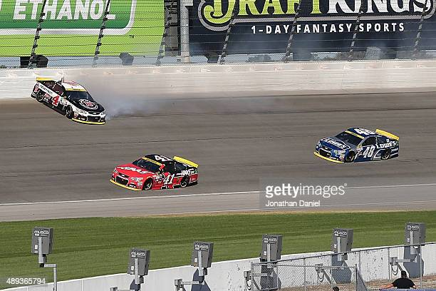 Kevin Harvick driver of the Jimmy John's / Budweiser Chevrolet spins after contact withs Jimmie Johnson driver of the Lowe's Chevrolet during the...