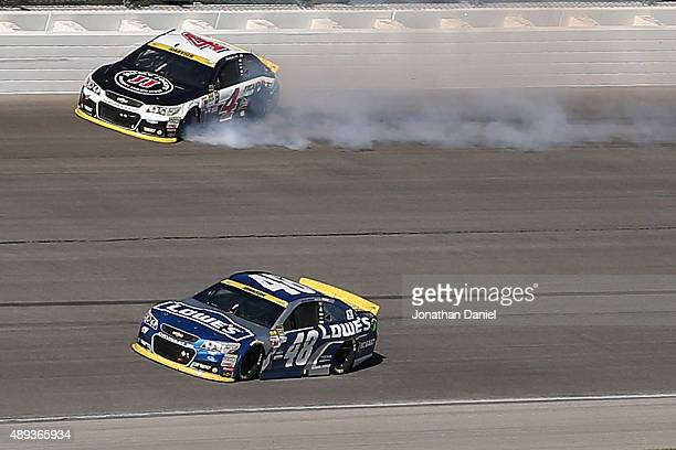 Kevin Harvick driver of the Jimmy John's / Budweiser Chevrolet spins after contact with Jimmie Johnson driver of the Lowe's Chevrolet during the...