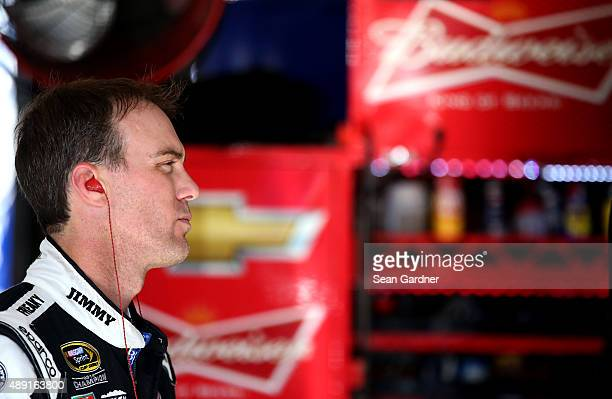 Kevin Harvick driver of the Jimmy John's / Budweiser Chevrolet stands in the garage area during practice for the NASCAR Sprint Cup Series...