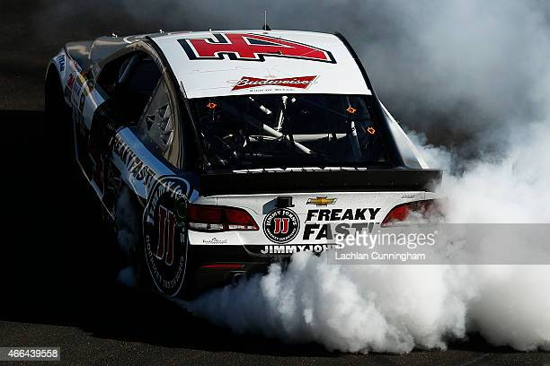 Kevin Harvick driver of the Jimmy John's/ Budweiser Chevrolet celebrates with a burnout after winning the NASCAR Sprint Cup Series CampingWorldcom...