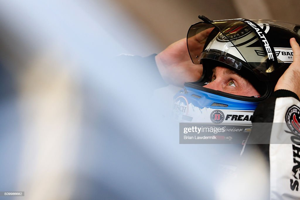 <a gi-track='captionPersonalityLinkClicked' href=/galleries/search?phrase=Kevin+Harvick&family=editorial&specificpeople=209186 ng-click='$event.stopPropagation()'>Kevin Harvick</a>, driver of the #4 Jimmy John's Chevrolet, adjusts his equipment in the garage area during practice for the NASCAR Sprint Cup Series Daytona 500 at Daytona International Speedway on February 13, 2016 in Daytona Beach, Florida.