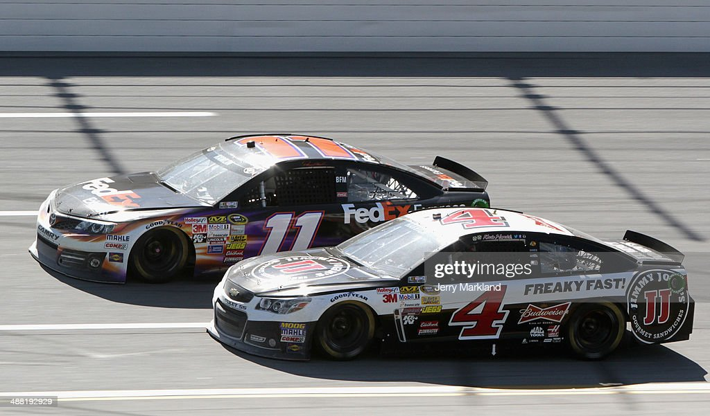 Kevin Harvick, driver of the #4 Jimmy John's Chevrolet, and Denny Hamlin, driver of the #11 FedEx Express Toyota, race during the NASCAR Sprint Cup Series Aaron's 499 at Talladega Superspeedway on May 4, 2014 in Talladega, Alabama.