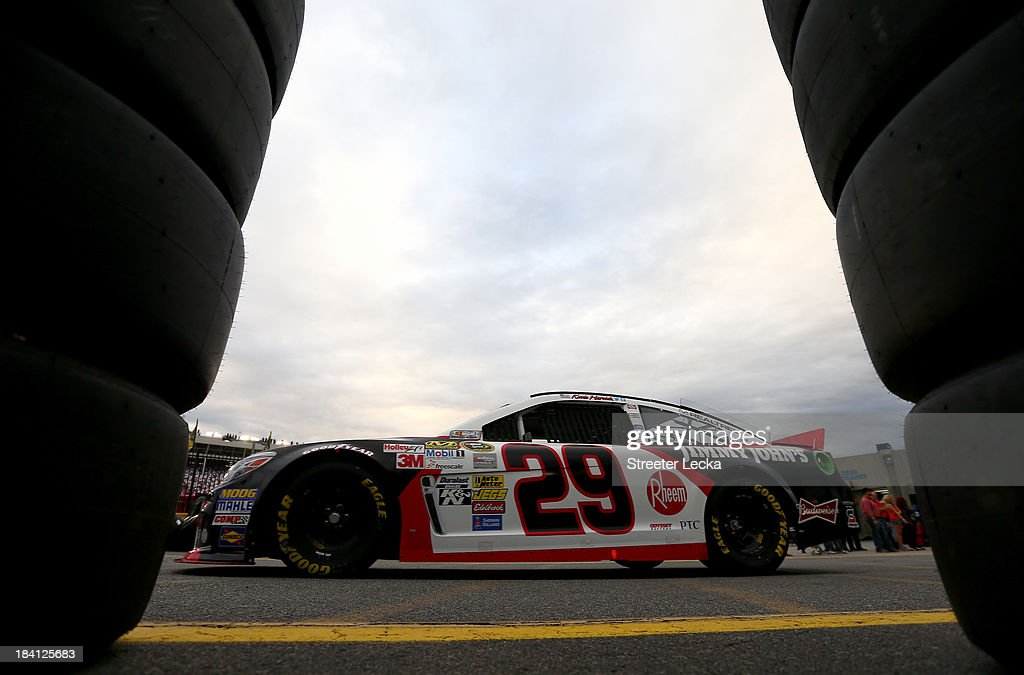 <a gi-track='captionPersonalityLinkClicked' href=/galleries/search?phrase=Kevin+Harvick&family=editorial&specificpeople=209186 ng-click='$event.stopPropagation()'>Kevin Harvick</a>, driver of the #29 Jimmy John's Chevrolet, drives through the garage area during practice for the NASCAR Sprint Cup Series Bank of America 500 at Charlotte Motor Speedway on October 11, 2013 in Concord, North Carolina.